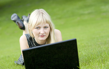 Lady using a notebook outdoors