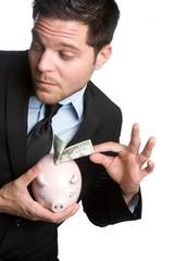 Man Stealing Money From Piggybank