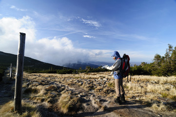 Woman hikerin mountain  to read a map