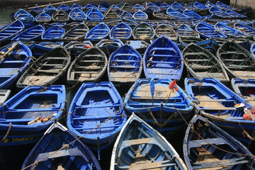 Blue fishing boats in Essaouira port, Morocco