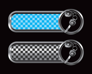 Car keys on blue and black checkered tabs