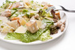 traditional caesar salad with chicken and parmesan cheese