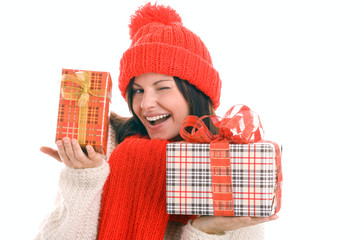 Woman holding two gifts winking