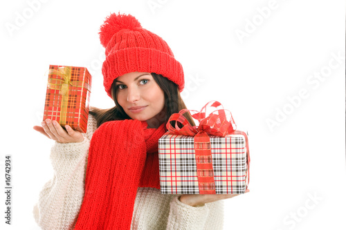 Pretty young woman holding two gifts