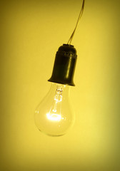 Photo of light bulb on yellow background