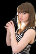 Attractive young woman with pistol. Isolated on black