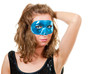 Young woman in blue mask