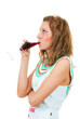 Woman drinks wine from a glass