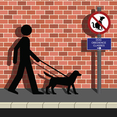 Man walking his dog to obedience class