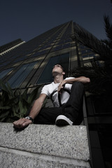 Man on a building ledge