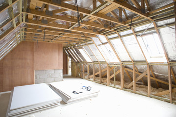 Plywood in attic under construction