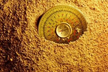 Feng shui compass in Sand