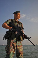Smart Asian Man In Soldier Uniform