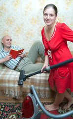 Woman running the vacuum cleaner