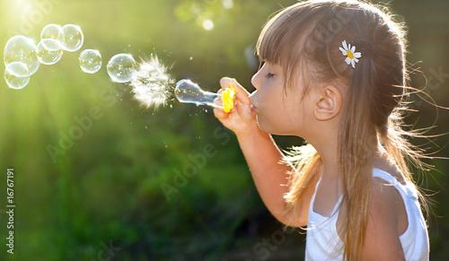 Leinwanddruck Bild Blowing soap bubbles