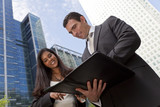 Businessman and Businesswoman Team Meeting In A Modern City