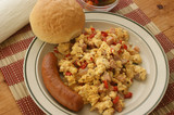 scrambled eggs with organic tomato, sausage and bacon poster