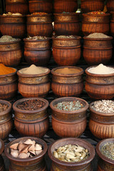 Beautifully carved handmade pots full of aromatic spices on the