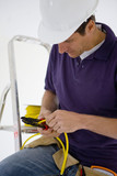 Electrician cutting cable