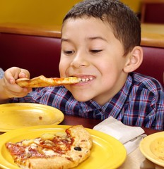 boy eating a pizza