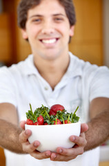 Man with a strawberries bowl