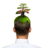man with tree blossoming on his head