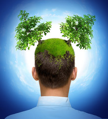 man with two trees growing on his head