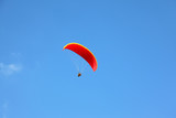 The operated red parachute flies in high poster
