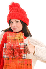 Woman with gifts giving thumbs up