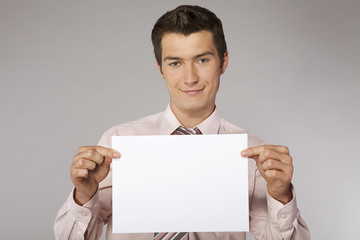 Young happy businessman with good sales results document in his
