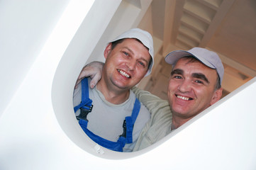 two smiling construction workers