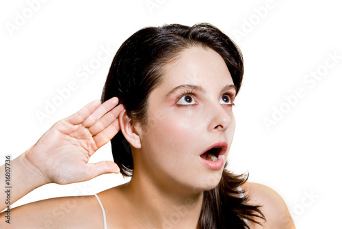 Girl listening shocked isolated on white