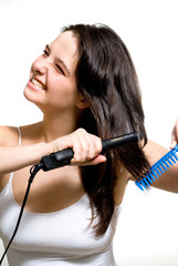 Girl ironing hair with difficulty