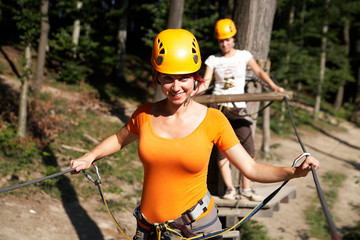 woman wearing climbing gear with helmet pulley and carabiner