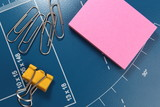 office stationery - paper clips and post-it pink note paper poster