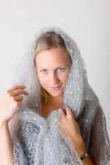 The woman in a woollen scarf