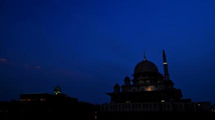 The Sun sets over The Putra Mosque at Putrajaya, Malaysia.