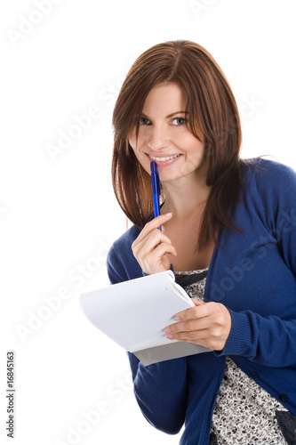 Young woman does records by pen in notepad smiling