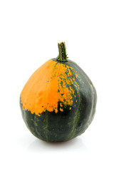 Orange with green gourd over white background