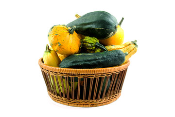 Basket with gourds over white background