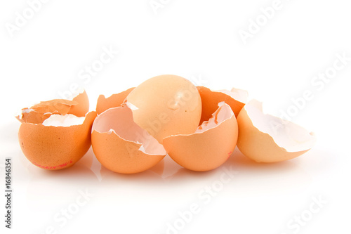 Lots of broken egg shells over white background - 16846354