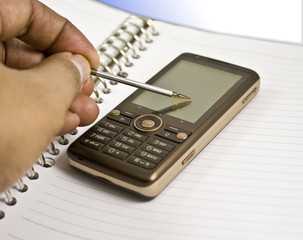 Blank Notebook, Stylus, Mobile Phone, Hand