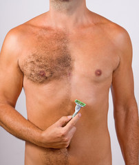 unshaved man with razor
