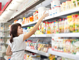 Young woman in the supermarket choose food