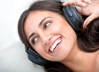 cheerful woman wih headphones