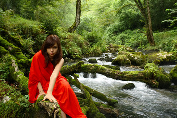 Girl in red at a brook