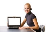 Young businesswoman or secretary with headset and laptop