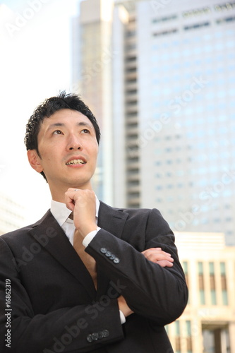 Businessman thinks about something