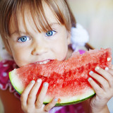 Fototapety Funny child eating watermelon