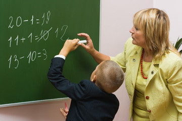 The pupil with the teacher at a mathematics lesson